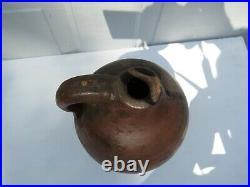 Antique Ovid pottery stoneware Jug 10 in