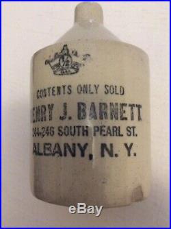 Henry J Barnett 244-46 S Pearl St Albany NY Antique stoneware pottery whisky jug